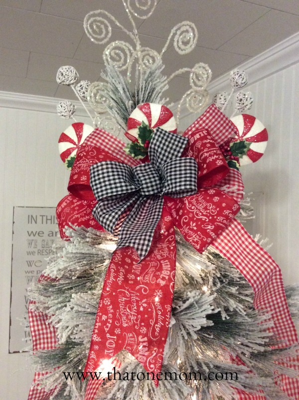Christmas Tree Topper with ribbons and peppermint lollipops